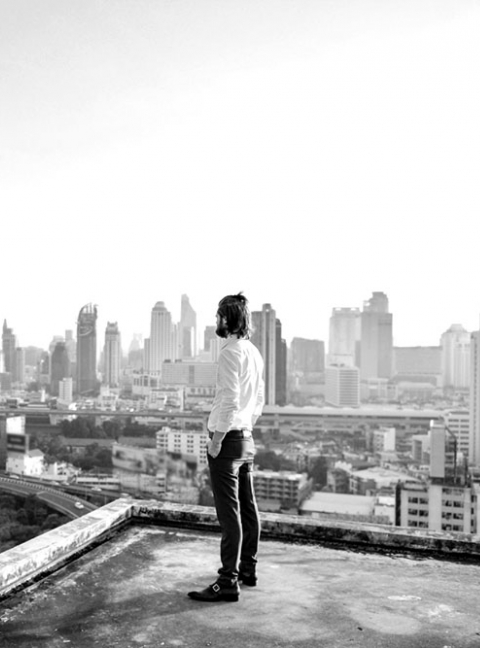 Person standing on the edge of a city